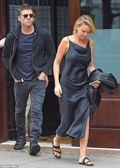 Stepping out: Lara Bingle and Sam Worthington were spotted in Tribeca in New York City on ...  The dress, the hair, the shoes, the man....