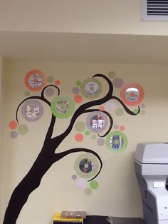 These are the rules or my computer lab written with sharpie on CD's.  I painted the tree then used scrap book paper for the circles.  I used those glue adhesive tape dispensers to attach everything.  Just run it around the edge of everything to get it flat against the wall.