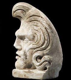 Elvis reincarnated! Ancient Roman acroterion, a decorative bust of a male figure from a sarcophagus. 150 AD