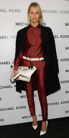 Karolina Kurkova in midnight and crimson deck stripe button front shirt and Samantha pant, and optic white Silverton tote all from the Michael Kors Spring 2013 collection.