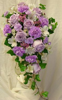 Wedding Cascade in purples | by Westosha Floral