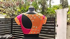 Designer net back blouse in pink and orange. Saree blouse design.