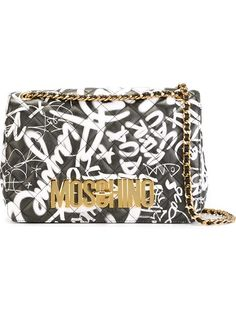 Shop Moschino quilted graffiti print crossbody bag in Julian Fashion from the world's best independent boutiques at farfetch.com. Shop 300 boutiques at one address.