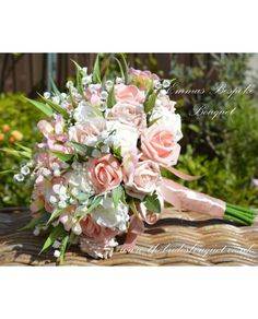 Bride to be Emma asked us to replicate one of our most popular designs in peach shades to compliment her wedding theme, with roses, hydrangea and lily of the valley it is a design we can create in a huge variety of different colours... contact us if you would like something similar making for your big day - just £40 http://www.thebridesbouquet.co.uk/mixed-flower-bouquet?search=fancy