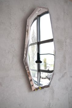 TAFLA is a collection of steel mirrors by Zieta Prozessdesign