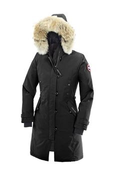Black Canada Goose Jacket - Long and slim-fitting, the Kensington Parka is equally appropriate for strolling a city street or hiking a snowy trail. With smart Military buttons, waist-cinching adjustable straps, and recessed rib knit cuffs, the Kensington is a modern take on a traditional style.