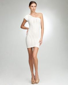 ...BEBE one-shoulder caged ruffle dress, super chic.