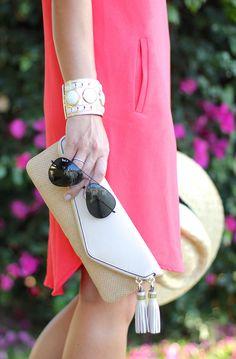 pink shift dress and tassel clutch