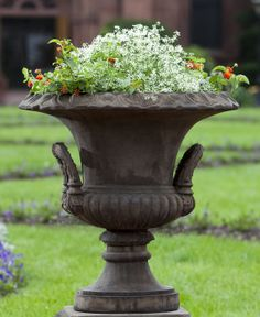SMITHSONIAN L'ENFANT URN   The Smithsonian L'Enfant Urn will work in any garden. An inverted fluted design wraps around the lower base while two extravagant handles extend upwards. This piece is topped off with an elaborately detailed curved rim as well. Choose from 12 color finishes.