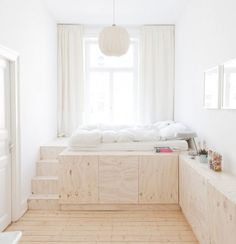 Minimal bedroom with built in storage designed by Studio Oink.