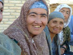 A group of Uzbek women smiling for the camera. Uzbekistan