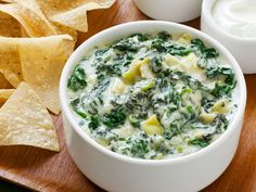Almost-Famous Spinach-Artichoke Dip from FoodNetwork.com . Six dip recipes here as well, not just the spinach-artichoke dip. Yummy!