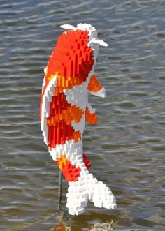 Reiman Gardens in Iowa has been 'pixelated' with 27 garden sculptures made by LEGO sculptor Sean Kenney, as part of the garden's 'Some Assembly Required' theme.