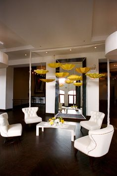 www.moderneventrental.com    Modern chic chairs.  white coffee table