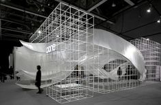 """Titled """"transparent shell"""", the installation comprises 30 main bone models and three groups of large curves, which are built by multiple layers of woven transparent film. These undulating layers take on an organic and sinuous form, creating a variety of functional spaces, such as an entrance, wall, ceiling, window, desktop and seating area."""