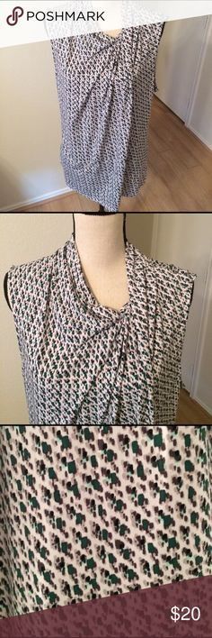 EUC NY&Co sleeveless top Sleeveless top with asymmetrical neckline. Drakes very nicely and has some stretch so is very flattering. Black, grey, mint, and dark green in the pattern. New York & Company Tops Blouses