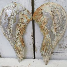 Distressed metal angel wings wall hanging rustic farmhouse rusty oxidized unique one of a kind home decor Anita Spero Design