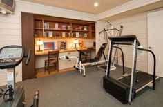Smart home gym with home office tucked away in the closet - Decoist