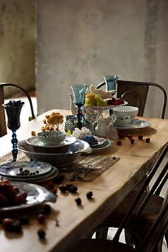 Lever and Lumber Table. The stacked plates definitely add to the feel. #anthropologie #PinToWin