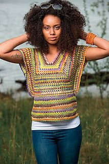 This crochet top is a basic granny square with butterfly wings on both sides and a scalloped edge.