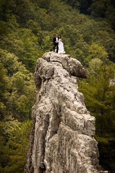Bob Ewing, 32, and Antonie Hodge, 30, pose at #SenecaRocks in West Virginia. The couple made the 900-foot climb in formal wedding attire. picture: John Ewing/AP