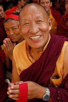 Very happy Tibetan Buddhist Monk holding ritual blindfold during Lamdre, Tharlam Monastery, Boudha, Kathmandu, Nepal - photo by: Wonderlane, Source: Flickr, found with Wylio.com