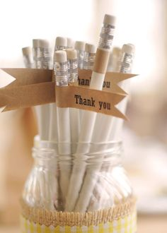 Pencil favors. Considering my love for office supplies, I feel like a riff on this idea could work for me...