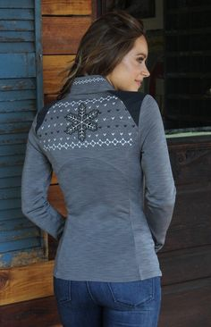 The perfect Winter Wonderland layering piece with an elaborate snowflake applique and detailed embroidery. Unique heathered coloring and empire waist for a great fit.85% Polyester 15% Spandex shoulder panels, 94% Polyester 6% Spandex Body.Moisture wicking, quick drying, breathable, and insulating.