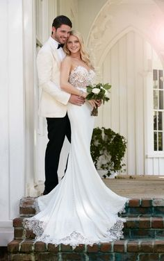 This sleek and sexy designer Martina Liana wedding gown features fine, natural lace and an illusion back that zips up under fabric-covered buttons. The skirt is made from Bellagio crepe and falls into a train that is embellished with scalloped lace. Designer Wedding Dresses, Used Wedding Dresses, Wedding Dress Trends, Cheap Wedding Dress, Wedding Dress Styles, Wedding Photo Inspiration, Bhldn Wedding, Mod Wedding, Lace Wedding