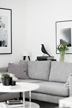 Slide 10 - A white colored room with black decorations and grey decor.A mix of styles, lots of contrast and different textures makes it a very interesting and beautiful home