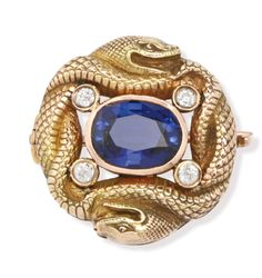 A Russian gold, sapphire, and diamond brooch, workmaster Konstantin Linke, Bolin, St. Petersburg, circa 1895, formed as two intertwined snakes centering a faceted sapphire with four diamonds at the corners.