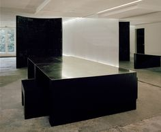 Rick Owens' House - Minimalist, brass-topped table, designed by Rick Owens