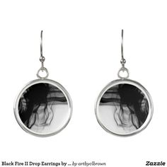 """Wear these unique sterling silver-plated drop earrings for any occasion. The Black Fire II Drop Earrings designed by Artist C.L. Brown feature fire photography converted to black and white. Earrings are silver plated, water-resistant, and have a fade-proof print sealed with a UV-resistant coating. This product is recommended for ages 13+ and has dimensions of 0.7"""" diameter. Made in USA."""