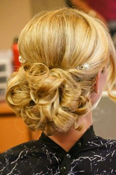My wedding hair. My poof with curls and a piece left out in front. Loved it!