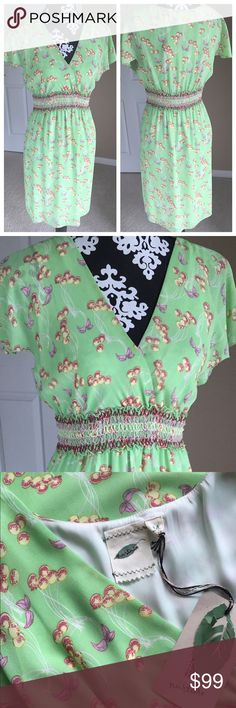 """Anthropologie Green Print Dress Brand new with tags.  I'm unsure of the name of this dress and had no luck finding it.  Good condition. 100% polyester. Measures about 36"""" long. V-neck, cap sleeves with detailed waist line. Size medium. Fits great on dress form that measures 35-26-36. Dress does stretch. Beautiful green color with yellow, red and pink. Anthropologie Dresses"""