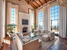 Casually Elegant Living Room with high ceilings and amazing windows
