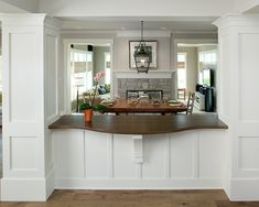 kitchen/dining room layout - open up the wall but keep the plumbing/ductwork in the pillars