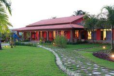 Casa Vermelha: Casas campestres por Andréa Calabria Arquitetura