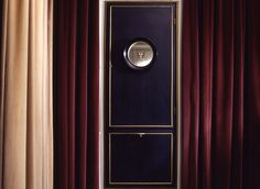 Carlo Mollino Turin apartment....leather and brass door with port hole window