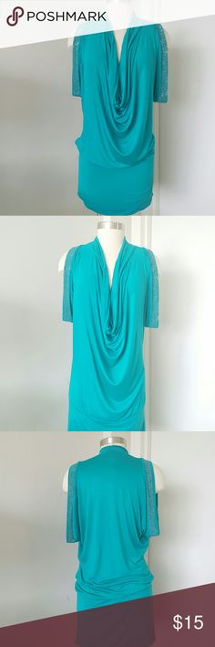 """Nikki Danielle Paris Tunic/Dress Great tunic can be wear as a tunic or dress, turquoise color,  unlined, 95% rayon 5%spandex measurements are length 36"""" bust 38"""" hips 36"""" oversized style. Nikki Danielle Paris  Dresses"""