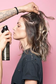 Grab a can of texturizing spray or dry shampoo — Tran prefers Oribe's Dry Texture Spray — and blast the roots of your hair, holding the spray 12 inches away from your head. Go section by section, and slowly layer the spray into your locks, avoiding the ends.If your hair is processed, dry, or naturally curly, you'll benefit from a texture spray with a touch of nourishing oil instead, like Oribe's Apres Beach Spray. Simply swap it in and follow the steps above.