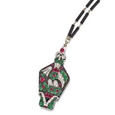 PLATINUM, DIAMOND, RUBY, EMERALD AND ENAMEL LORGNETTE AND CHAIN, MAUBOUSSIN, FRANCE, CIRCA 1927 Of floral design, set with cabochon rubies and emeralds, a square cabochon onyx, and old European-cut, round and single-cut diamonds weighing approximately 3.00 carats, enclosing a pair of hinged lenses, supported by a onyx and platinum link chain