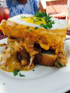 Brunchin @bonelickbbq and I am thrilled! This Cajun Croque is everything! House cured Tasso,Swiss cheese spicy remoulade,garlic toast, fried egg and Louisiana hollandaise!