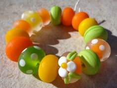 Orange, yellow and lime green lampwork beads.