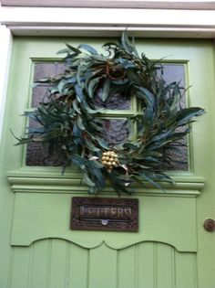 Festive wreath on this front door. Door painted in Saxon Green Estate Eggshell