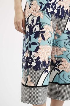 Printed culottes in a polka dot print and floral print repping the mixing prints fashion trend.