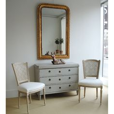cold but effective; mirror, pair of chair and the swedish chest