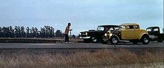"""Classic race scene from the movie """"American Graffiti"""". Toad uses a flash light to start the race out on Paradise Road between John Milner's yellow Deuce coupe and the black 1955 Chevy. """"Geez...what a night!"""""""