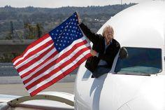 Sir Richard Branson waves in the inaugural flight at SFO
