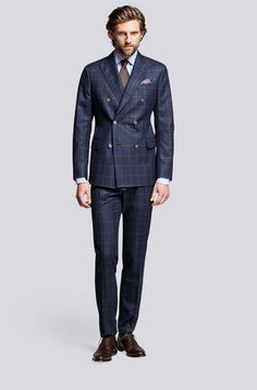 Double Breasted Suit with brown Window-pane check pattern. Paired with complementing solid brown necktie.